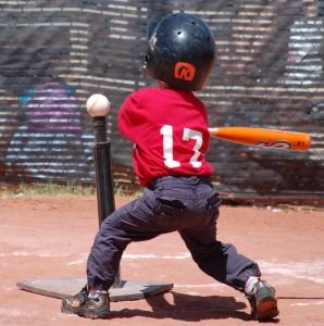 Tee_ball_player_swinging_at_ball_on_tee_2010